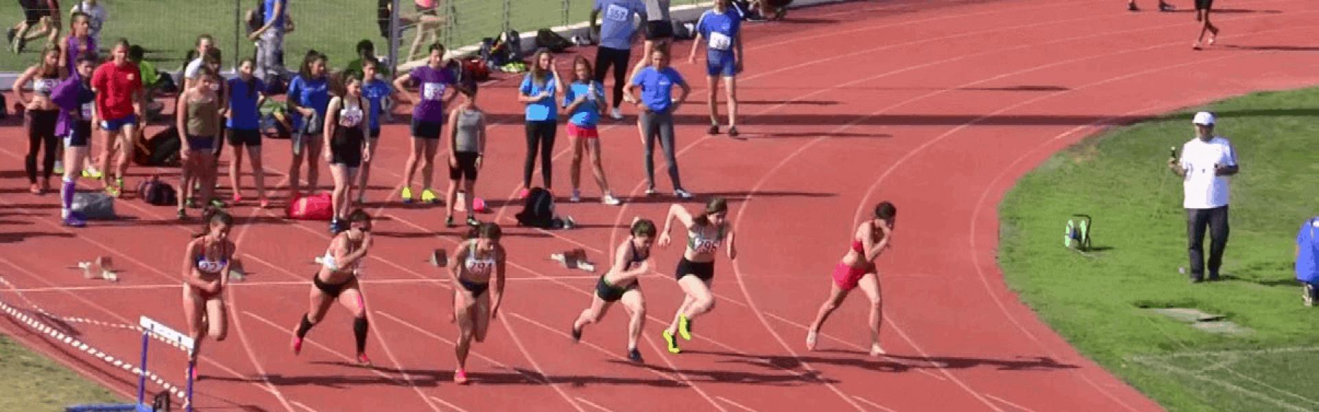 Athletes run in a stadium