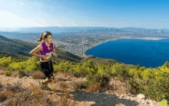 Athletes run on a mountain